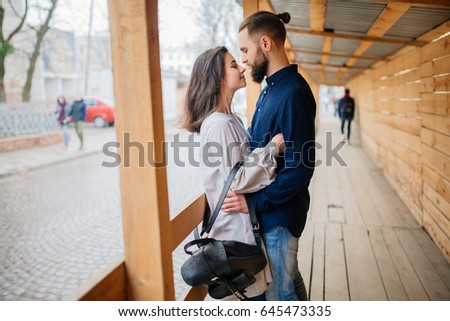 Young couple in love, hugging on the street #645473335