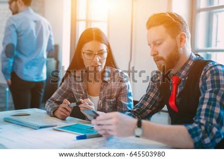 Startup Teamwork Brainstorming Meeting concept in office #645503980
