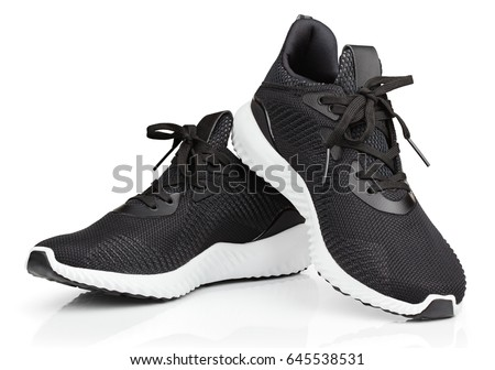 Pair of new unbranded black sport running shoes or sneakers isolated on white background with clipping path #645538531