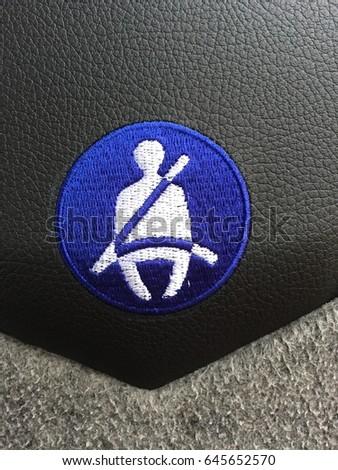 Fasten Seat Belt Symbol On Tour Bus #645652570