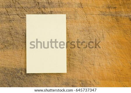 Yellow note paper on wooden background, rectangle note paper. #645737347