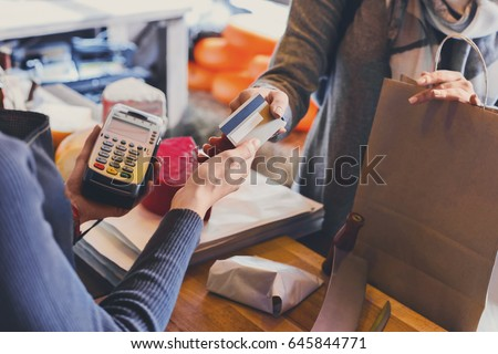 Retail, credit card payment service. Customer paying for order of cheese in grocery shop. Royalty-Free Stock Photo #645844771