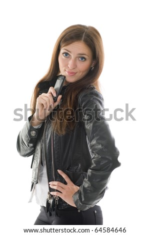 Beautiful girl in black leather jacket and a mobile phone in his hand #64584646