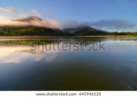 Beautiful scenic sunrise color at a lake with reflections #645946120