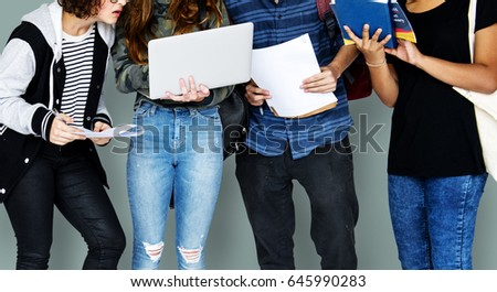 Group of Diverse High School Students Using Digital Devices Studio Portrait #645990283