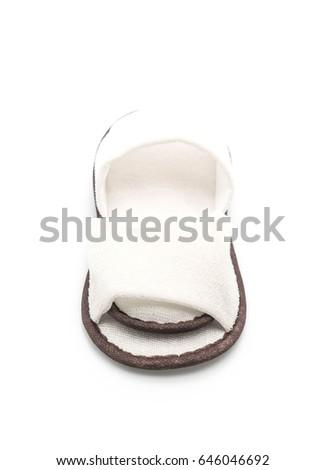 white slippers on white background #646046692