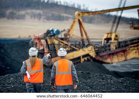 Coal mine workers in an open pit #646064452