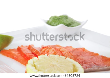 green sauce and salmon with lemon on white #64608724