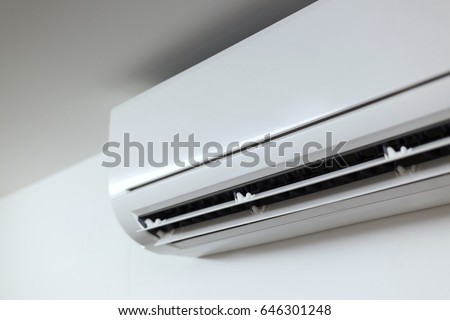 air conditioner cooling fresh system saving energy on white wall background #646301248