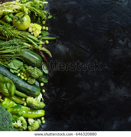 Mix of green vegetables on a dark background close up  #646320880