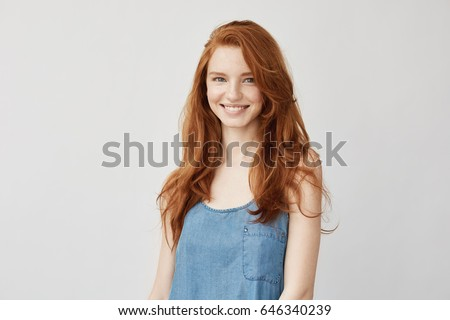 Young attractive redhead girl smiling looking at camera. #646340239