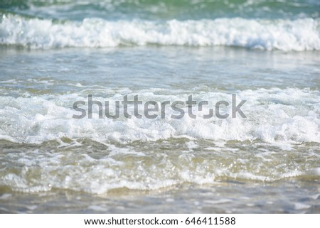 Soft wave of the sea near the beach.(Selective focus.) #646411588