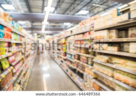 Blur selection of baby food & supplies, household cleaners, paper goods, pet necessities on shelves in store at Houston, Texas, US. Defocused background aisles, rows and variety product in supermarket #646489366