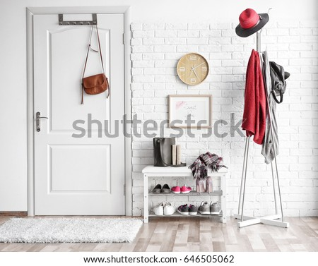 Modern hall interior with hanging clothes Royalty-Free Stock Photo #646505062