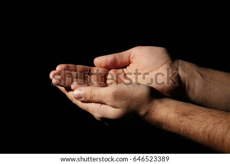 Male hands on a black background #646523389
