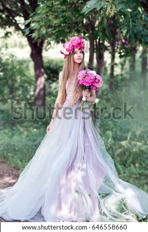 Beautiful girl  in the peony wreath outdoor on green background. Woman with peonies. Series. #646558660
