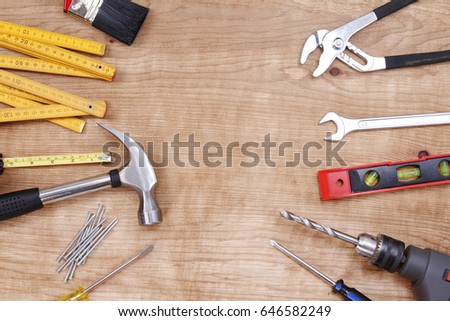 Assorted work tools on wood #646582249
