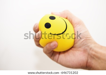 Hand squeeze yellow stress ball, on white background, anger management, positive thinking concepts #646731202