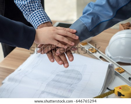 Business Engineering United Hands together with spirit, teamwork concepts. #646765294