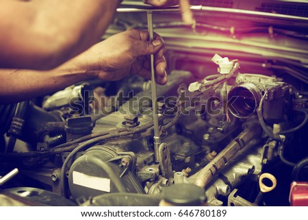 The hand is repairing the piston engine. #646780189