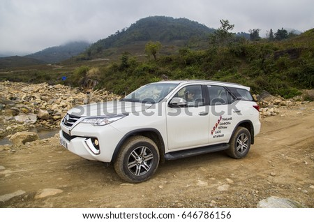 Lao Cai, Vietnam - Mar 17, 2017: Toyota Fortuner 2017 SUV in a test drive for ability on multi terrains in mountain are, Vietnam. #646786156