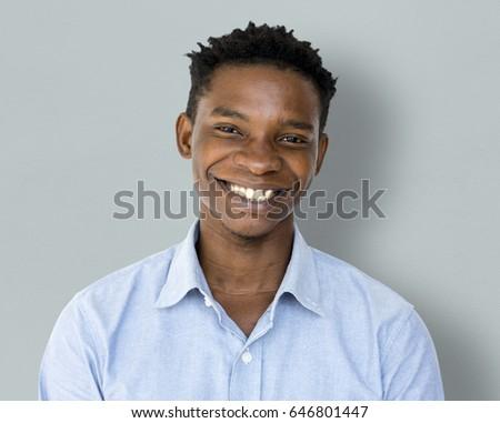 Happiness african man smiling studio portrait #646801447