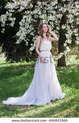 Modern bride. A distinguished wedding dress with a loop #646841866