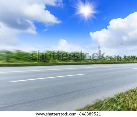 Country asphalt road,Motion blurred road background #646889521