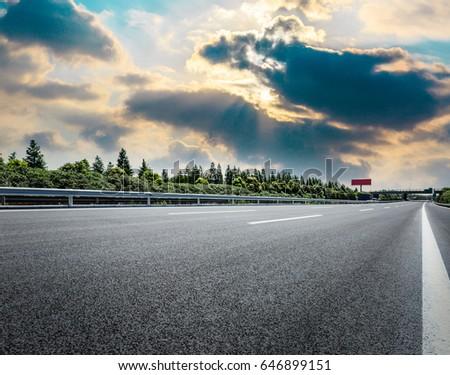 Country asphalt road at dusk #646899151