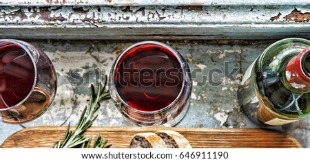 Red wine and snacks. Christmas, Thanksgiving, wine, Parmesan, rosemary, bread. Flat position, top view, closeup. #646911190