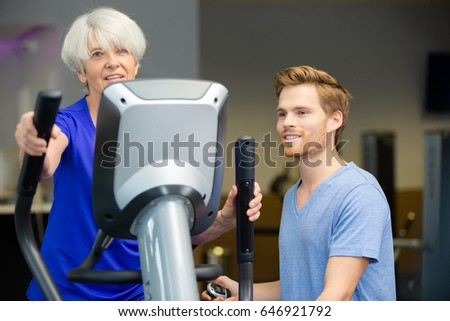 senior woman and trainer smiling at camera in fitness studio #646921792