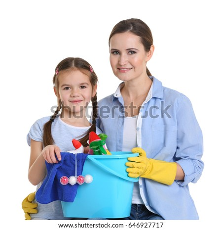 Mother and daughter with cleaning supplies, isolated on white #646927717