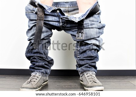 An Image of a man with down pants #646958101