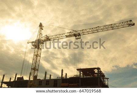 Building crane orange in the background of the sky and the object under construction #647019568