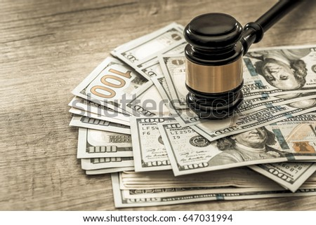 wooden gavel with usa dollar on desk. close up. toned image Royalty-Free Stock Photo #647031994