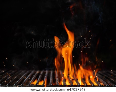 Empty flaming charcoal grill with open fire, ready for product placement. Concept of summer grilling, barbecue, bbq and party. Black copyspace Royalty-Free Stock Photo #647037349
