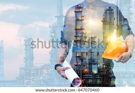 Double exposure of Engineer with safety helmet  with oil refinery industry plant background  Royalty-Free Stock Photo #647070460