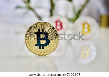 Cryptocurrency physical colored bitcoin coins. Pink bitcoin, blue bitcoin and yellow bitcoin #647109103