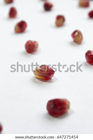 Red pomegranate seeds isolated on white background. #647271454