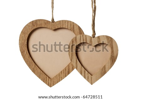 small and large wooden picture frames on strings, isolated on white