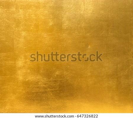Gold background metal sheet metal surface gold Royalty-Free Stock Photo #647326822