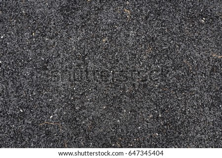 dark grey rough stone concrete road texture #647345404