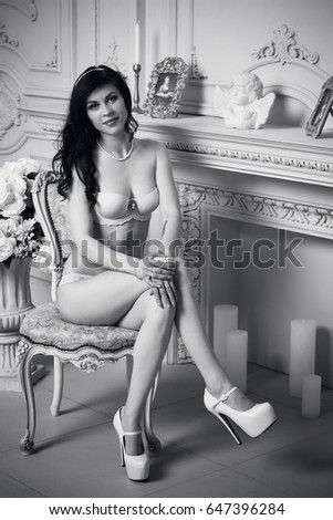 Sexy and attractive woman in white lingerie and pearl jewelry in  luxury interior #647396284