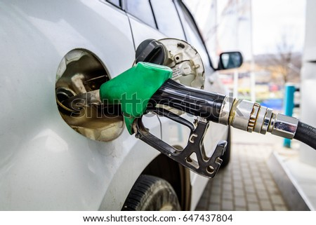 Petrol gun with car. #647437804