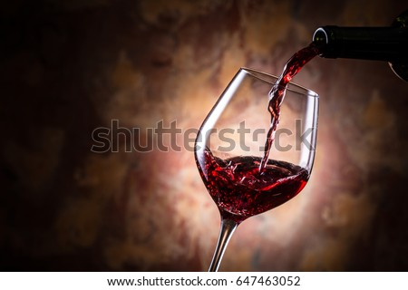 Pour red wine #647463052