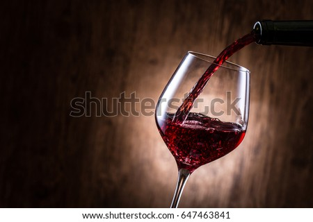 Pour red wine #647463841