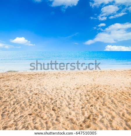 Beautiful white clouds on blue sky over calm sea with sunlight reflection #647510305