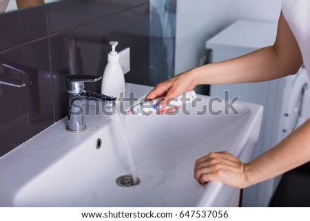 Morning routine. Young woman using cosmetics at her home #647537056