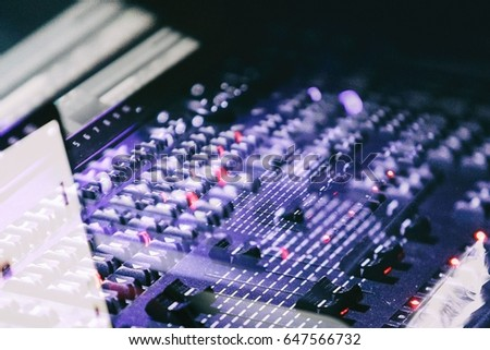 MOSCOW - 19 NOVEMBER,2016: Sound technician & lights technicians control the show.Professional audio & light mixer,mixing console with regulators.Lighting equipment for concerts & night club party #647566732