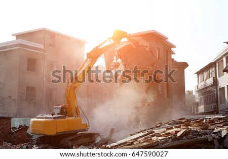 Bulldozer demolished old building. Royalty-Free Stock Photo #647590027